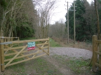 Gated access from the road and parking for Fosse Wood