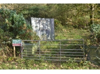 Woodland entrance and steel container