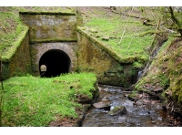 The tunnel where Hell Beck flows under the railway track