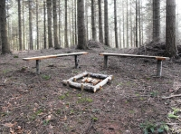 Double bench with a fire pit to entertain family and friends