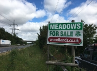 sign on A47 close to meadow