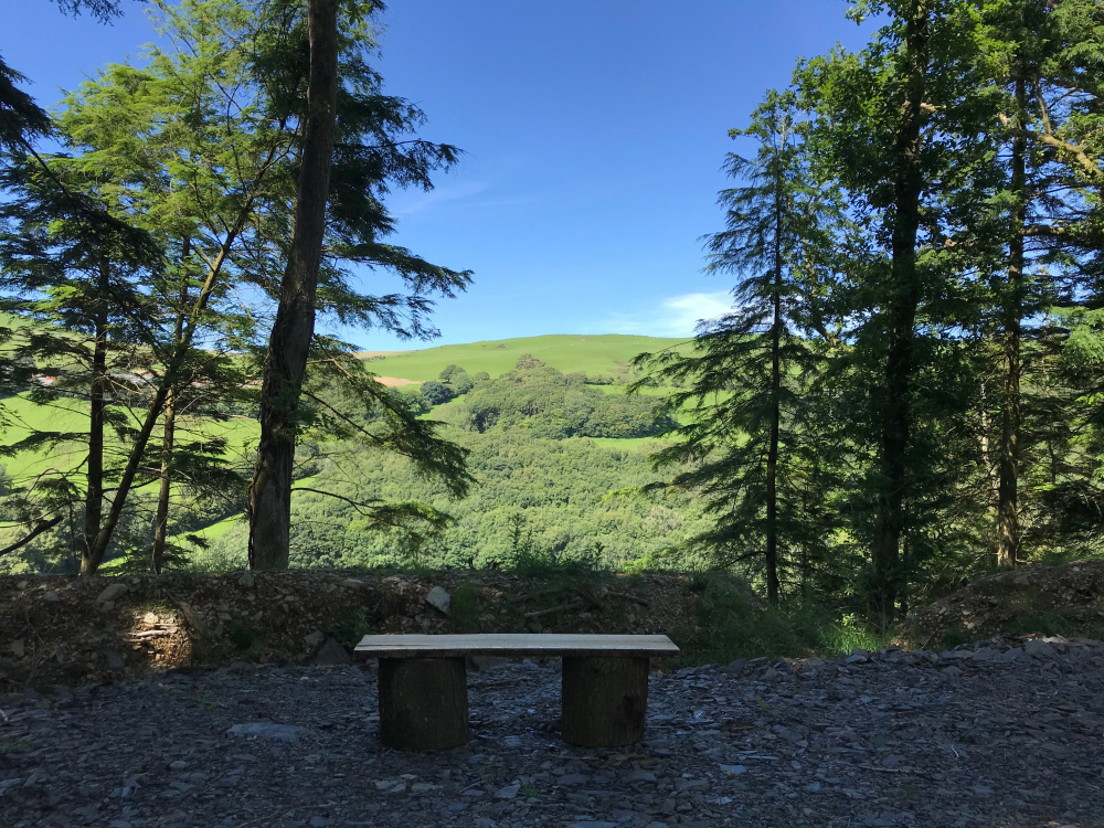 Handmade bench with a beautiful view out across the valley