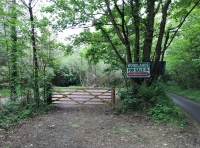 Main gate into woodland, park up here