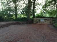 Parking area and main gate into woodland