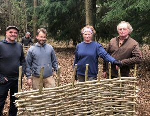 Learning to make a hurdle with hazel rods