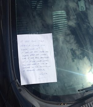 Communicating through a note on the windscreen